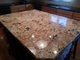 Gold and Silver granite island with Black Pearl granite perimeter - two-tone kitchen with complementary colors