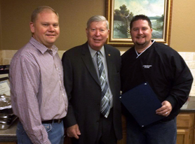 Don Reimel (center) presents proclamation to Jeff Williams and Aaron Toney on Legendary Stone Day, November 3, 2011